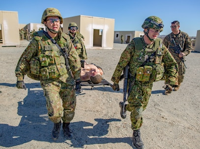 MARINE CORPS BASE CAMP PENDLETON, Calif. – Japan Ground Self Defense Soldiers run a simulated casualty to the pick up zone during exercise Iron Fist 2018, Jan. 22. Iron Fist is an annual, bilateral training exercise where U.S. and Japanese service members train together and share techniques, tactics and procedures to improve their combined operational capabilities. (U.S. Marine Corps photo by Cpl. Jacob A. Farbo)