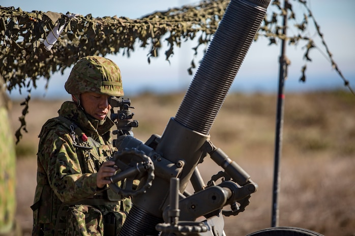 MARINE CORPS BASE CAMP PENDLETON, Calif. – A Japan Ground Self Defense Force Soldier aims down the sights of a Dragon Fire 120-Millimeter Heavy Mortar on San Clemente Island during exercise Iron Fist 2018, Feb. 2. Exercise Iron Fist brings together U.S. Marines from the 11th Marine Expeditionary Unit and Soldiers from the JGSDF, Western Army Infantry Regiment, to improve their bilateral planning, communicating, and conducting of combined amphibious operations. (U.S. Marine Corps photo by Cpl. Jacob A. Farbo)