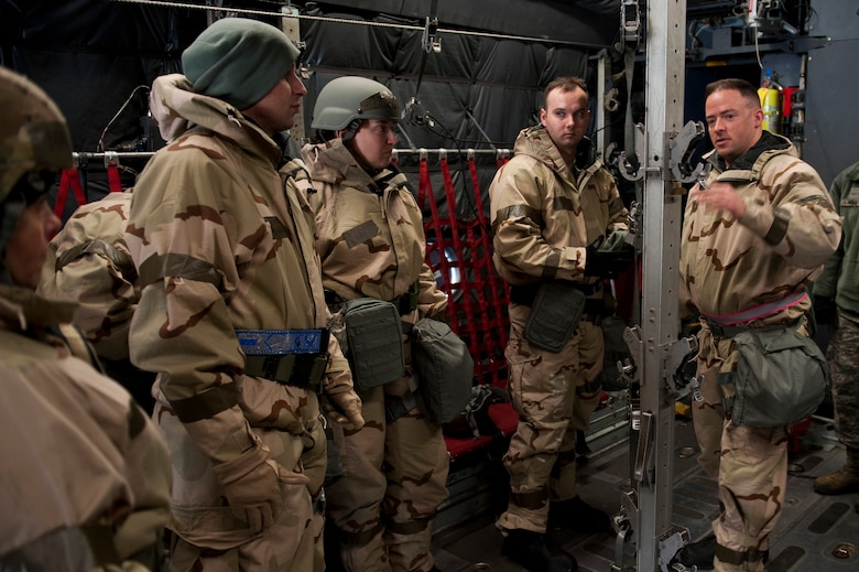 Tech. Sgt. Jacob Appleby, 375th Aeromedical Evacuation Squadron mission management NCO in charge, explains how to prepare the inside of a C-130 Hercules for patient transport during an exercise at Scott Air Force Base, Illinois, Feb. 6, 2018. The 375th AES provides rapid response aeromedical evacuation capability for any contingency. (U.S. Air Force photo by Staff Sgt. Clayton Lenhardt)