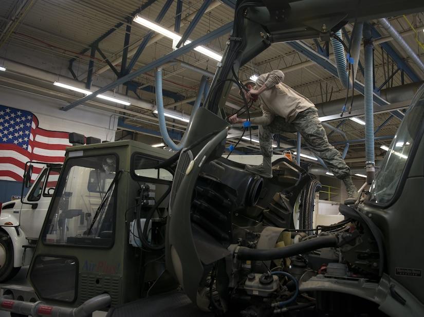 U.S. Air Force Senior Airman John Hipple, 628th Logistics Readiness Squadron, mission generation vehicular equipment maintenance journeyman, replaces hydraulic lines on a vehicle in the LRS main shop Feb. 15.
