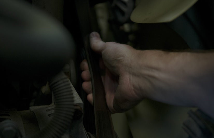 U.S. Air Force Senior Airman John Hipple, 628th Logistics Readiness Squadron, mission generation vehicular equipment maintenance journeyman, checks belt tension and wear on a vehicle in the LRS main shop Feb. 15.