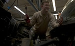 U.S. Air Force Senior Airman John Hipple, 628th Logistics Readiness Squadron, mission generation vehicular equipment maintenance journeyman, checks the transmission fluid on a vehicle in the LRS main shop Feb. 15.