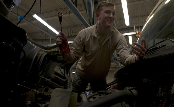 U.S. Air Force Senior Airman John Hipple, 628th Logistics Readiness Squadron, mission generation vehicular equipment maintenance journeyman, checks the transmission fluid on a vehicle in the LRS main shop Feb. 15.
