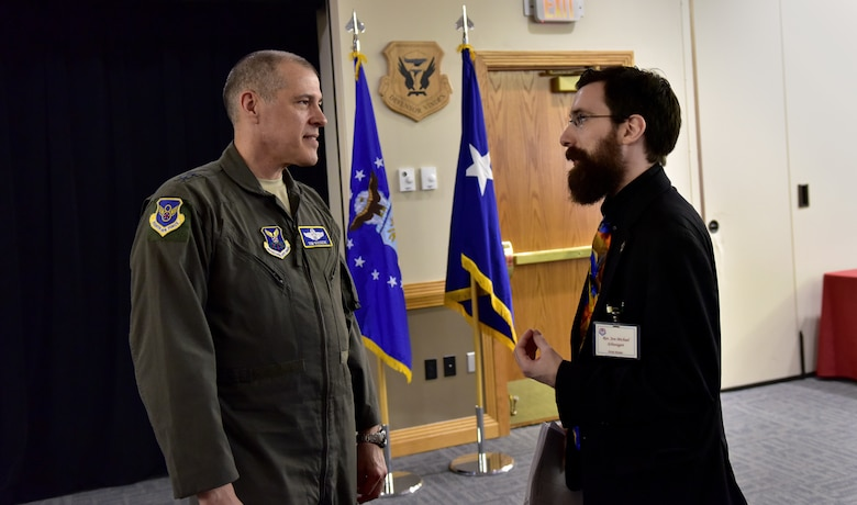U.S. Air Force Maj. Gen. Thomas Bussiere, commander of the 8th Air Force, speaks with Rev. Jon-Michael Schweigert, the Knob Noster community liaison, following the monthly luncheon at Whiteman Air Force Base, Mo., Feb. 14, 2018.