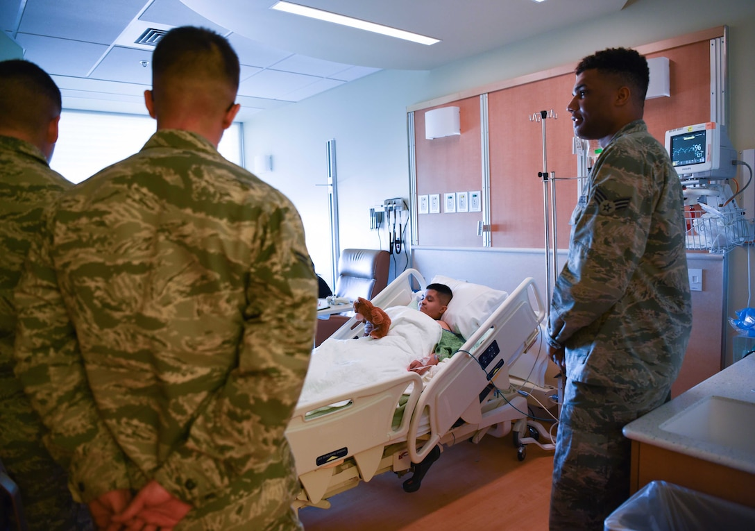 Airmen from F.E. Warren Air Force Base, Wyo., deliver teddy bears to the Children's Hospital Colorado, Aurora, Colorado, Feb. 14, 2018. Most of the children admitted to the hospital make it their temporary home by decorating their room to fit their personality because they spend extended periods of time there. 100 bears were donated by the Warren Top 3, a private organization on base, to hand out to the children in the neurology and orthopedic wings. (U.S. Air Force photo by Airman 1st Class Abbigayle Wagner)