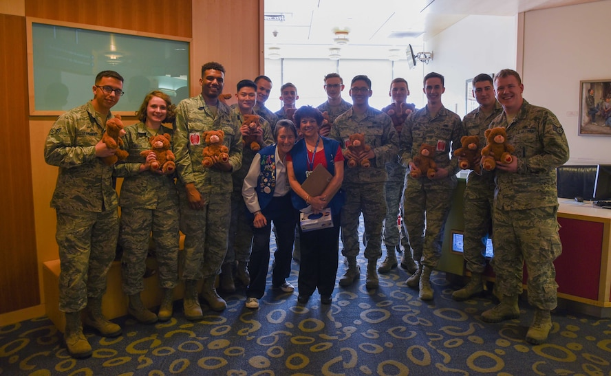 Thirteen Airmen from F.E. Warren Air Force Base, Wyo., spent the afternoon at the Children's Hospital Colorado, Aurora, Colorado, Feb. 14, 2018, with two volunteer leads coordinating a teddy bear delivery. Senior Airman Sitry Jordan, 790th Missile Maintenance Squadron missile maintainer and teddy bear delivery organizer, enjoyed the experience of bringing Valentine's Day to the children and hopes to make this an annual event for future Airmen. 100 bears were donated by the Warren Top 3, a private organization on base, to hand out to the children in the neurology and orthopedic wings. (U.S. Air Force photo by Airman 1st Class Abbigayle Wagner)