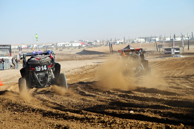 Garison Callaway (1914) of St. George, Utah, left, and Marcos  Johnson (86) of Locust, Calif., tear into the track at the start of the Can-Am KOH UTV Race, Feb. 7, 2018, in Johnson Valley, Calif. The UTV race is one of five held during King of the Hammers, the largest off-road racing and rock-crawling event in North America. Neither driver placed in the race, which was won by Mitch Guthrie Jr. of Glendora, Calif. (Marine Corps photo by Kelly O'Sullivan)