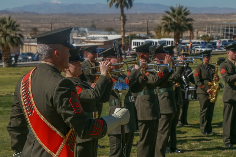 "Marines with the 1st Marine Division band begin the pre-ceremony serenade before the deactivation ceremony of D Company ""Dragoons"" aboard the Marine Corps Air Ground Combat Center, Twentynine Palms, Calif., Feb. 09, 2018. D Company was deactivated by order of the Commandant of the Marine Corps after 32 years of service. (U.S. Marine Corps photo by Lance Cpl. Preston L. Morris)"