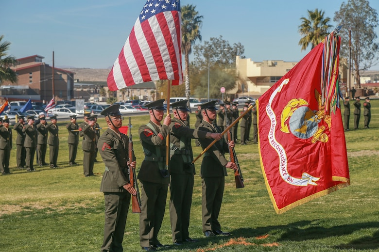 """The 3rd Light Armored Reconnaissance Battalion color guard presents the national colors  during the D Company """"Dragoons"""" deactivation ceremony aboard the Marine Corps Air Ground Combat Center, Twentynine Palms, Calif., Feb. 09, 2018. D Company was deactivated by order of the Commandant of the Marine Corps after 32 years of service. (U.S. Marine Corps photo by Lance Cpl. Preston L. Morris)"""