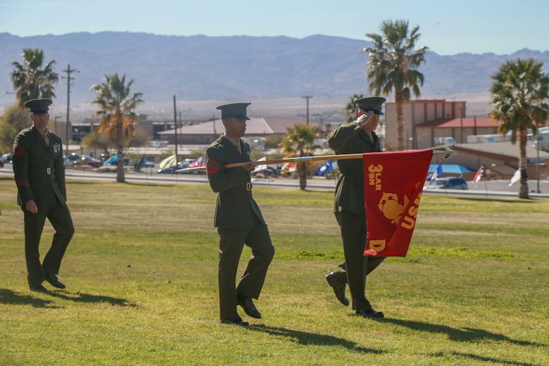 "The company guidon and commander of D Company ""Dragoons"" lead the company in a pass in review during its deactivation ceremony aboard the Marine Corps Air Ground Combat Center, Twentynine Palms, Calif., Feb. 09, 2018. D Company was deactivated by order of the Commandant of the Marine Corps after 32 years of service. (U.S. Marine Corps photo by Lance Cpl. Preston L. Morris)"