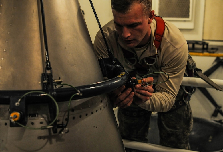Senior Airman Andrew Parrish, 90th Missile Maintenance Squadron topside technician, performs maintenance on the forward section of a reentry system, Feb. 2, 2018, in the F. E. Warren Air Force Base missile complex. The 90th MMXS maintains approximately 150 Minuteman III ICBMs. Missile maintenance teams perform periodic maintenance to maintain the on-alert status for launch facilities, ensuring the success of the nuclear deterrence mission. (U.S. Air Force photo by Airman 1st Class Braydon Williams)