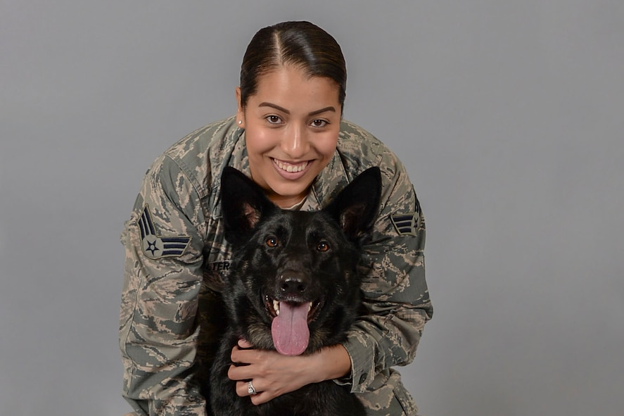 Senior Airman Katherine Walters, 375th Air Mobility Wing Public Affairs broadcast journalist, and her German Shepherd, Jodi, have been utilizing the Scott Air Force Base Veterinary Treatment Facility for two years. (U.S. Air Force photo by Senior Airman Melissa Estevez)