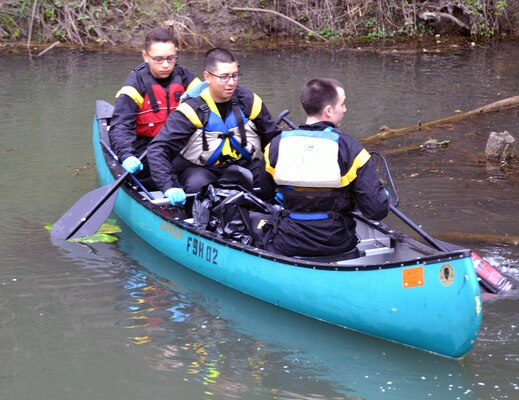 A trio of Soldiers show their prowess on the water as they search the shores of Salado Creek for trash during the annual Basura Bash at Joint Base San Antonio-Fort Sam Houston Feb. 17.