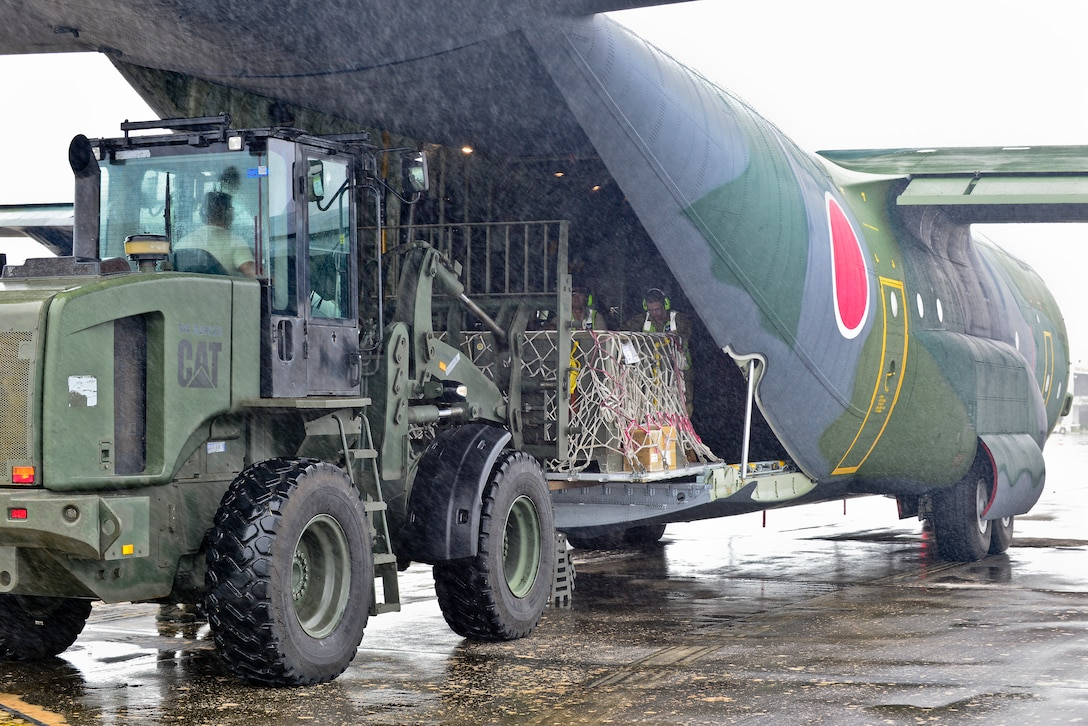 U.S. Air Force and Royal Australian Air Force humanitarian assistance/disaster relief personnel unload a Koku Jieitai (Japanese Air Self-Defense Force) C-130H Hercules in support of exercise COPE NORTH 2018 at Rota, U.S. Commonwealth of the Northern Mariana Islands, Feb. 17. An annual exercise, this year's COPE NORTH is a multilateral HA/DR exercise that allows participating nations to prepare for and recover from the devastating effects of natural disasters. (U.S. Air Force photo by Airman 1st Class Christopher Quail)