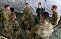 U.S. Air Force, Royal Australian Air Force and Koku Jieitai (Japan Air Self-Defense Force) humanitarian assistance/disaster relief (HA/DR)  exercise leaders discuss mission scenarios during COPE NORTH 2018 at Rota, U.S. Commonwealth of the Northern Mariana Islands, Feb. 17. An annual exercise, this year's COPE NORTH is a multilateral HA/DR exercise that allows participating nations to prepare for and recover from the devastating effects of natural disasters. (U.S. Air Force photo by Airman 1st Class Christopher Quail)