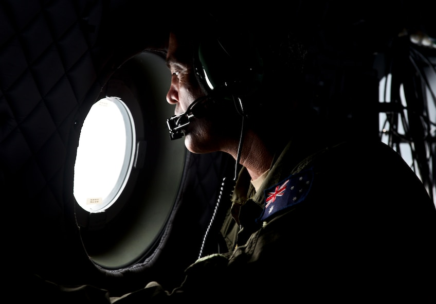 Royal Australian Air Force Warrant Officer Dwayne Taylor, loadmaster, looks out of a RAAF C-27J Spartan heading back to Andersen Air Force Base, Guam, during exercise COPE NORTH 2018, Feb. 17. An annual exercise, this year's COPE NORTH is a multilateral HA/DR exercise that allows participating nations to prepare for and recover from the devastating effects of natural disasters. (U.S. Air Force photo by Airman 1st Class Christopher Quail)