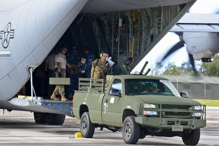 U.S. Air Force and Royal Australian Air Force humanitarian assistance/disaster relief (HA/DR) participants unload a USAF C-130J Super Hercules during exercise COPE NORTH 2018 at Rota, U.S. Commonwealth of the Northern Mariana Islands, Feb. 17. An annual exercise, this year's COPE NORTH is a multilateral HA/DR exercise that allows participating nations to prepare for and recover from the devastating effects of natural disasters. (U.S. Air Force photo by Airman 1st Class Christopher Quail)