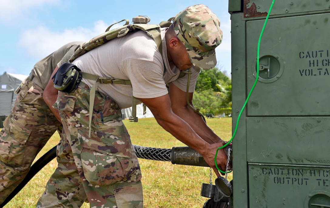 U.S. Air Force Master Sgt. Carlo Narvasa, 36th Contingency Response Group flight chief of operations, sets up a power unit during exercise COPE NORTH 2018 at Rota, U.S. Commonwealth of the Northern Mariana Islands, Feb. 17. An annual exercise, this year's COPE NORTH is a multilateral HA/DR exercise that allows participating nations to prepare for and recover from the devastating effects of natural disasters. (U.S. Air Force photo by Airman 1st Class Christopher Quail)