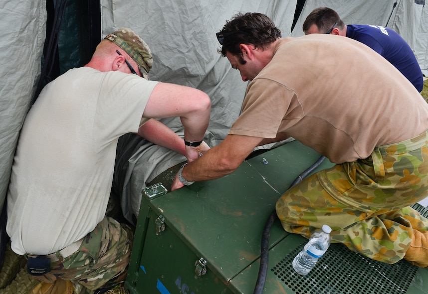 U.S. Air Force and Royal Australian Air Force humanitarian assistance/disaster relief (HA/DR) personnel set up an ac unit during exercise COPE NORTH 2018 at Rota, U.S. Commonwealth of the Northern Mariana Islands, Feb. 17. An annual exercise, this year's COPE NORTH is a multilateral HA/DR exercise that allows participating nations to prepare for and recover from the devastating effects of natural disasters. (U.S. Air Force photo by Airman 1st Class Christopher Quail)