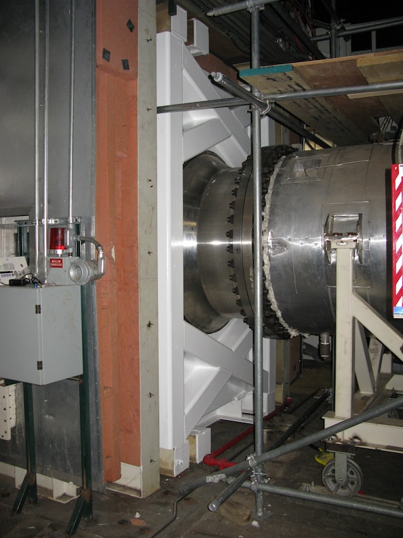 The plenum for the AEDC T-11 engine test cell at Arnold Air Force Base was modified by installing a spool piece that enabled the installation of a plenum apparatus and provided the interface for the plug-in modules. Pictured is an outside view of the plenum modification. (AEDC photo)