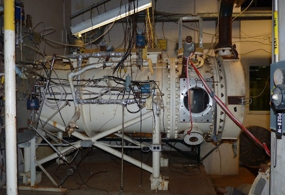 The AEDC T-11 engine test cell at Arnold Air Force Base was recently modified as part of effort in the AEDC technology program to develop test and evaluation techniques that will prepare the Complex to meet future vision system weapon requirements. To implement a plug-in module concept, the T-11 plenum was modified by installing a spool piece that enabled the installation of a plenum apparatus and provided the interface for the plug-in modules. Pictured is the Research Cell R1D section that will become a plug-in module for T-11. (AEDC photo)