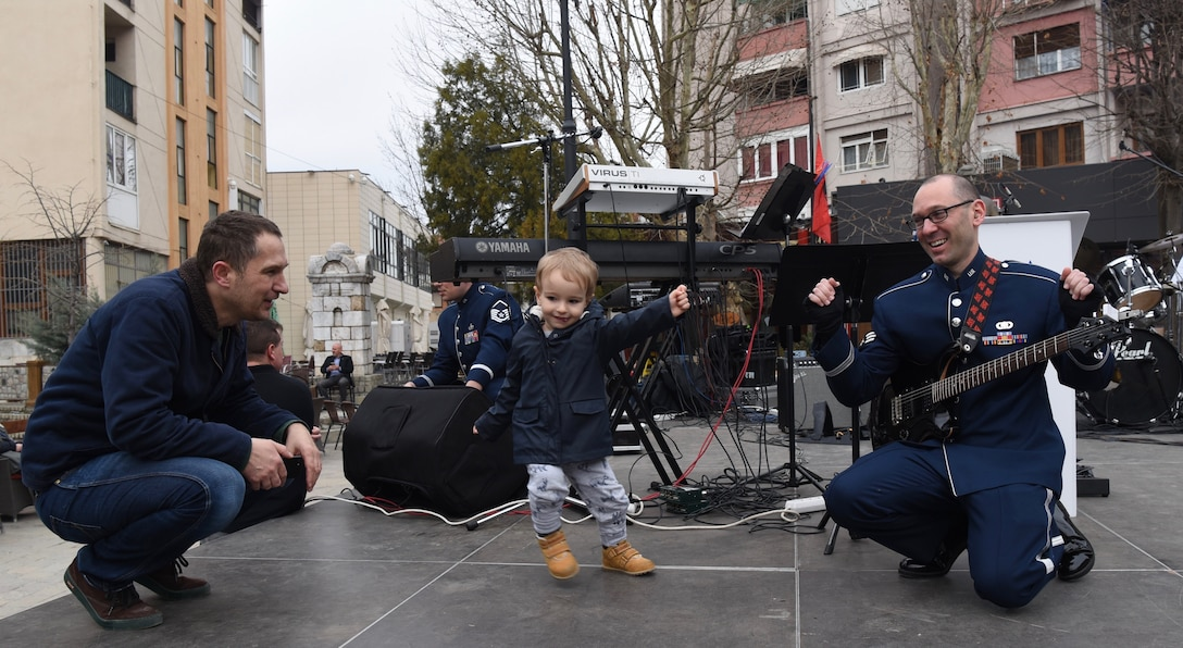 The U.S. Air Forces in Europe Band interacts with community members before a performance in Prizren, Kosovo, Feb. 18, 2018. The band was in Kosovo to celebrate the 10th anniversary of Kosovo independence. (U.S. Air Force photo by Maj. Tristan Hinderliter)