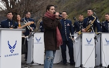 "The U.S. Air Forces in Europe Band performs in Prizren, Kosovo, in celebration of the country's 10th anniversary of independence, Feb. 18, 2018. During the performance, the band brought onstage Kosovar musician Denisa Sadiku, a vocalist who excelled on the show ""The Voice Albania,"" and Anda Gjini, a flute player in her final semester studying music at the University of Pristina. (U.S. Air Force photo by Maj. Tristan Hinderliter)"