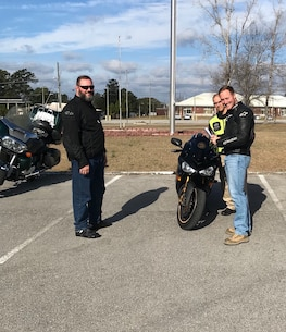 On February 16, 2018 as part of the Motorcycle Mentorship Program (MMP), Marines conducted level three motorcycle safety training. For this advanced ride Marines:  received a brief and discussed specific motorcycle handling techniques, conducted pre-ride inspections, took a local ride to practice the specific motorcycle handling techniques, returned to debrief the techniques, received additional training, and then conducted a longer ride that exercised all the discussed techniques. The MMP is designed to capitalize on the riding experience of mature, seasoned riders and to share that knowledge with other riders. Pictured from left to right:  Mr. Jerry Roeder, GySgt Alfred Negron, SSgt Zach Weatherwax.