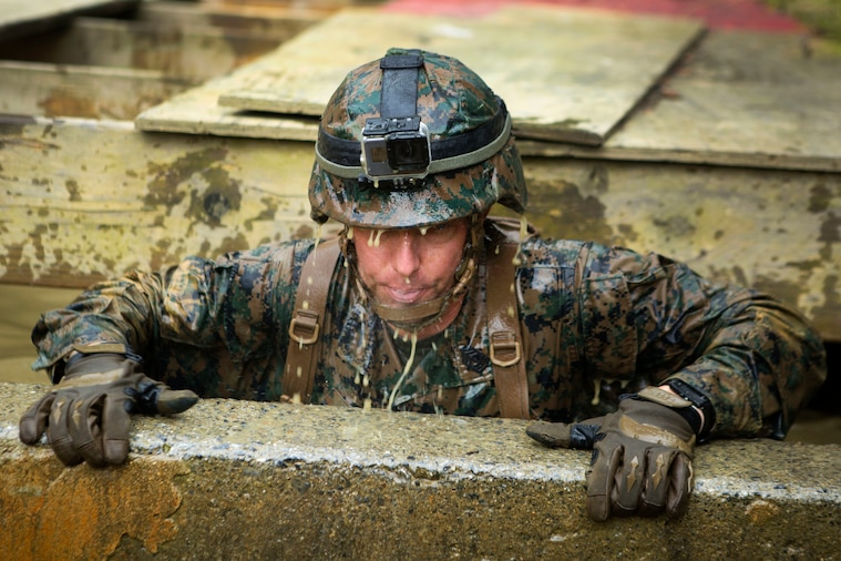 Marines tackle obstacles during the Endurance Course at Camp Gonsalves, Okinawa, Japan, Feb. 16, 2018. Photos by Marine Corps Lance Cpl. Jamin M. Powell