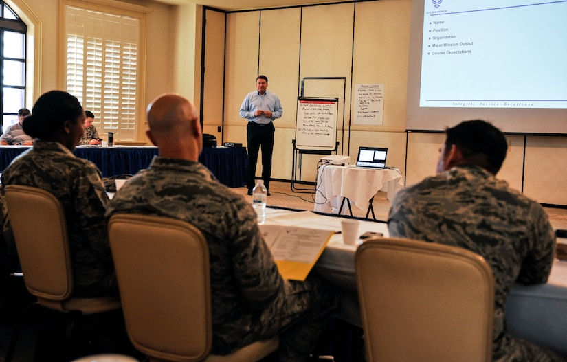 Phil Chansler, assistant professor of operations management with Air Education and Training Command, Maxwell Air Force Base, Ala., conducts a continuous process improvement course Feb. 15, 2018, at Joint Base Charleston, S.C.
