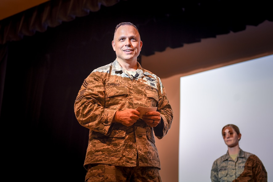 Chief Master Sgt. Matthew Caruso, command senior enlisted leader of U.S. Transportation Command, speaks to senior NCOs Feb. 15, 2018, during an all call at the theater on Seymour Johnson Air Force Base, North Carolina.