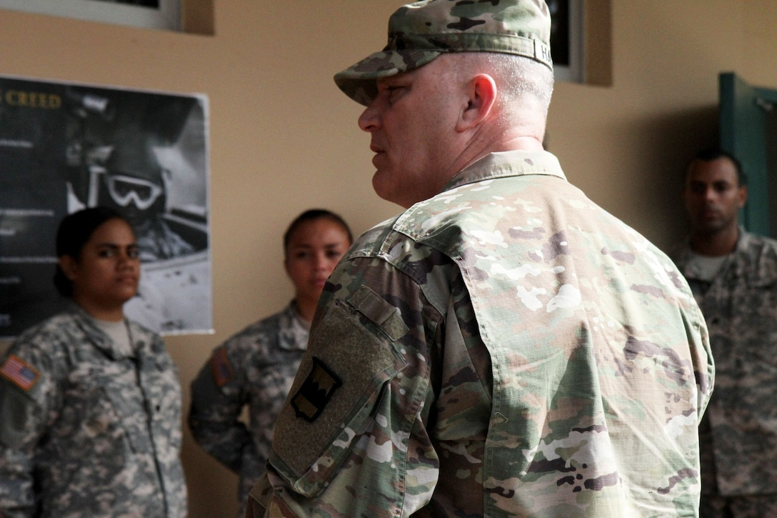 Maj. Gen. Bruce Hackett, commanding general of the 80th Training Command, talks with students of the mortuary affairs specialist course at Fort Buchanan, 14 February 2018. Maj. Gen. Hackett and Brig. Gen. Lopez were at Fort Buchanan to celebrate the reopening and relocation of a schoolhouse for the 94th Training Division's 5th Battalion. They were also on the island to assist with the planned tranistion and approved reassignment of all units stationed in Puerto Rico to the operational control of the 1st Mission Support Command.  Photo by Army Master Sgt. Benari Poulten, 80th Training Command (TASS) Public Affairs