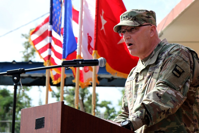 Maj. Gen. Bruce Hackett, commanding General of the 80th Training Command speaks at the ribbon-cutting ceremony at Fort Buchanan, Puerto Rico to celebrate the reopening and relocation of a schoolhouse for the 94th Training Division's 5th Battalion on 13 February 2018. The 5th BN's previous schoolhouse was severely damaged by the devastation of Hurricane Maria. Maj. Gen. Hackett and Brig. Gen. Hector Lopez, commanding general of the 94th Training Division, were also on the island to assist with the planned tranistion and approved reassignment of all units stationed in Puerto Rico to the operational control of the 1st Mission Support Command.  Photo by Army Master Sgt. Benari Poulten, 80th Training Command (TASS) Public Affairs