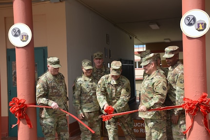 Maj. Gen. Bruce Hackett, commanding General of the 80th Training Command, and Brig. Gen. Hector Lopez, commanding general of the 94th Training Division, take part in the ribbon-cutting ceremony at Fort Buchanan, Puerto Rico to celebrate the reopening and relocation of a schoolhouse for the 94th Training Division's 5th Battalion on 13 February 2018. The 5th BN's previous schoolhouse was severely damaged by the devastation of Hurricane Maria. Maj. Gen. Hackett and Brig. Gen. Lopez were also on the island to assist with the planned tranistion and approved reassignment of all units stationed in Puerto Rico to the operational control of the 1st Mission Support Command.
