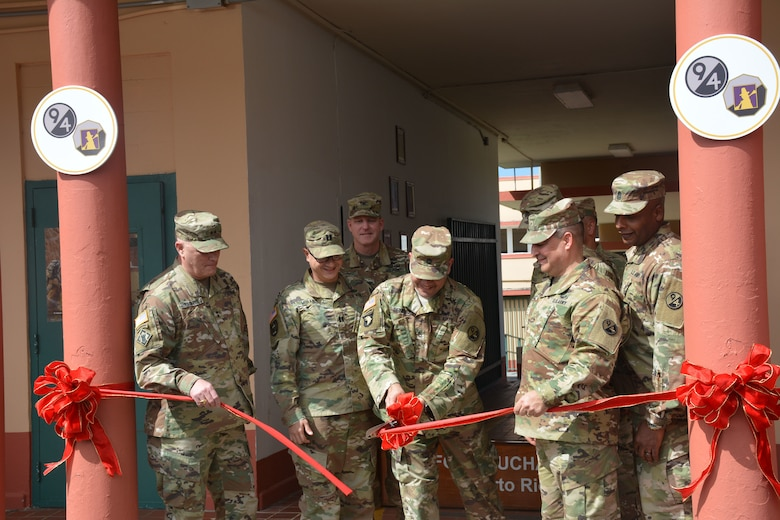 Maj. Gen. Bruce Hackett, commanding General of the 80th Training Command, and Brig. Gen. Hector Lopez, commanding general of the 94th Training Division, take part in the ribbon-cutting ceremony at Fort Buchanan, Puerto Rico to celebrate the reopening and relocation of a schoolhouse for the 94th Training Division's 5th Battalion on 13 February 2018. The 5th BN's previous schoolhouse was severely damaged by the devastation of Hurricane Maria. Maj. Gen. Hackett and Brig. Gen. Lopez were also on the island to assist with the planned tranistion and approved reassignment of all units stationed in Puerto Rico to the operational control of the 1st Mission Support Command.  Photo by Army Major Ebony Malloy, 94th Training DIV-FS Public Affairs