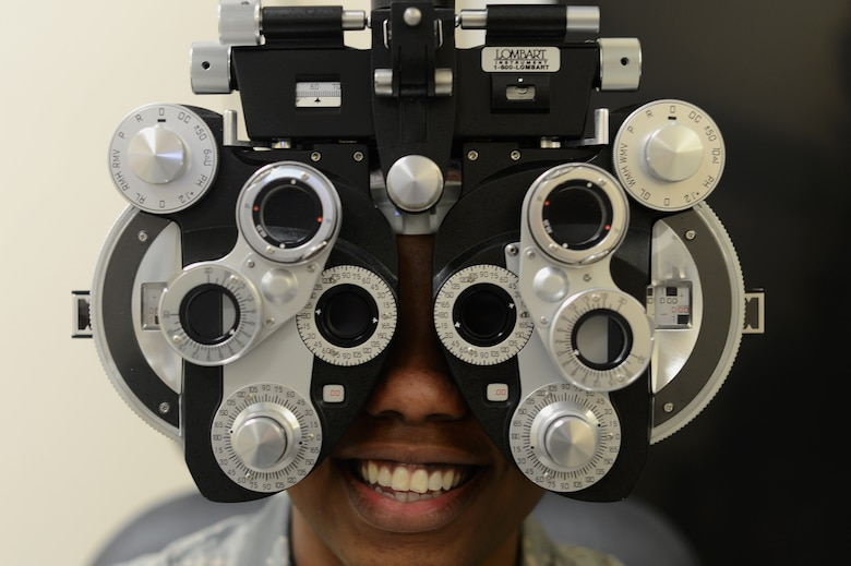 A patient looks through a diopter instrument at the 48th Medical Group optometry clinic, Jan. 17, 2018. The optometry clinic's goal is to provide the best care they can to active duty members and their dependents. (U.S. Air Force photo/Senior Airman Elizabeth Taranto)