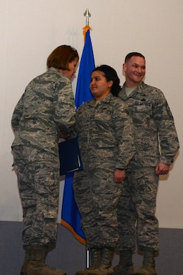 Team McChord Airmen and family members clap during the newly revived enlisted promotion ceremony, Jan. 30, 2018, at Joint Base Lewis-McChord, Wash.