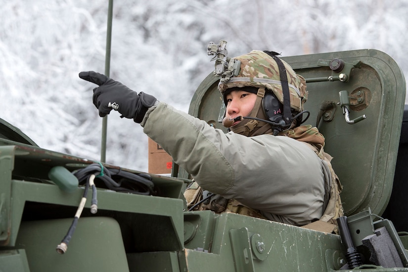 Army 1st Lt. Daniel Choi, assigned to Bayonet Company, 1st Battalion, 5th Infantry Regiment, 1st Stryker Brigade Combat Team, 25th Infantry Division, U.S. Army Alaska, directs his Stryker armored vehicle while preparing for live-fire gunnery training during Operation Punchbowl at Joint Base Elmendorf-Richardson, Alaska, Feb. 16, 2018. Operation Punchbowl was a battalion-level, combined arms, live-fire exercise that focused on arctic lethality.