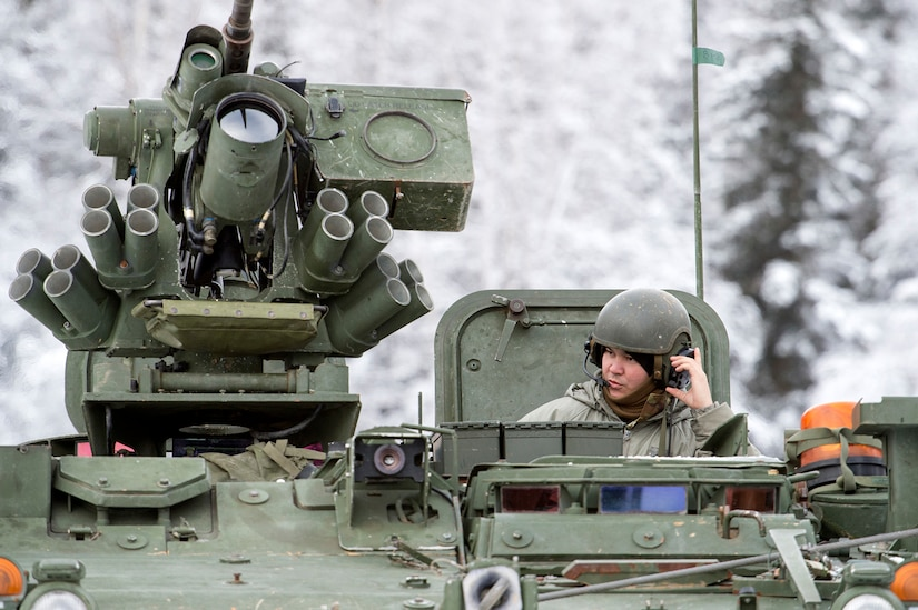A Soldier assigned to Bayonet Company, 1st Battalion, 5th Infantry Regiment, 1st Stryker Brigade Combat Team, 25th Infantry Division, U.S. Army Alaska, relays information via radio while preparing for live-fire gunnery training during Operation Punchbowl at Joint Base Elmendorf-Richardson, Alaska, Feb. 16, 2018. Operation Punchbowl was a battalion-level, combined arms, live-fire exercise that focused on arctic lethality.