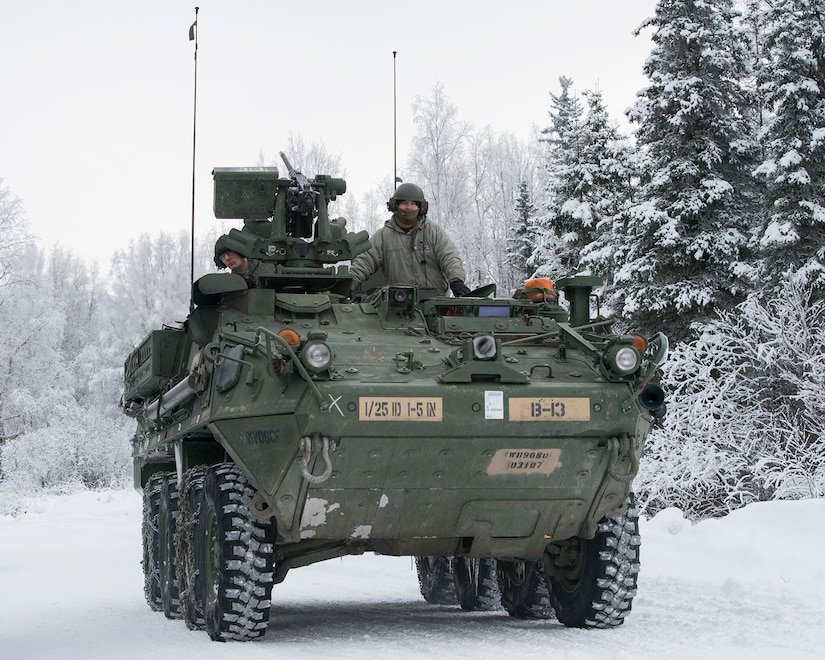 Soldiers assigned to Bayonet Company, 1st Battalion, 5th Infantry Regiment, 1st Stryker Brigade Combat Team, 25th Infantry Division, U.S. Army Alaska, prepare for live-fire gunnery training during Operation Punchbowl at Joint Base Elmendorf-Richardson, Alaska, Feb. 16, 2018. Operation Punchbowl was a battalion-level, combined arms, live-fire exercise that focused on arctic lethality.