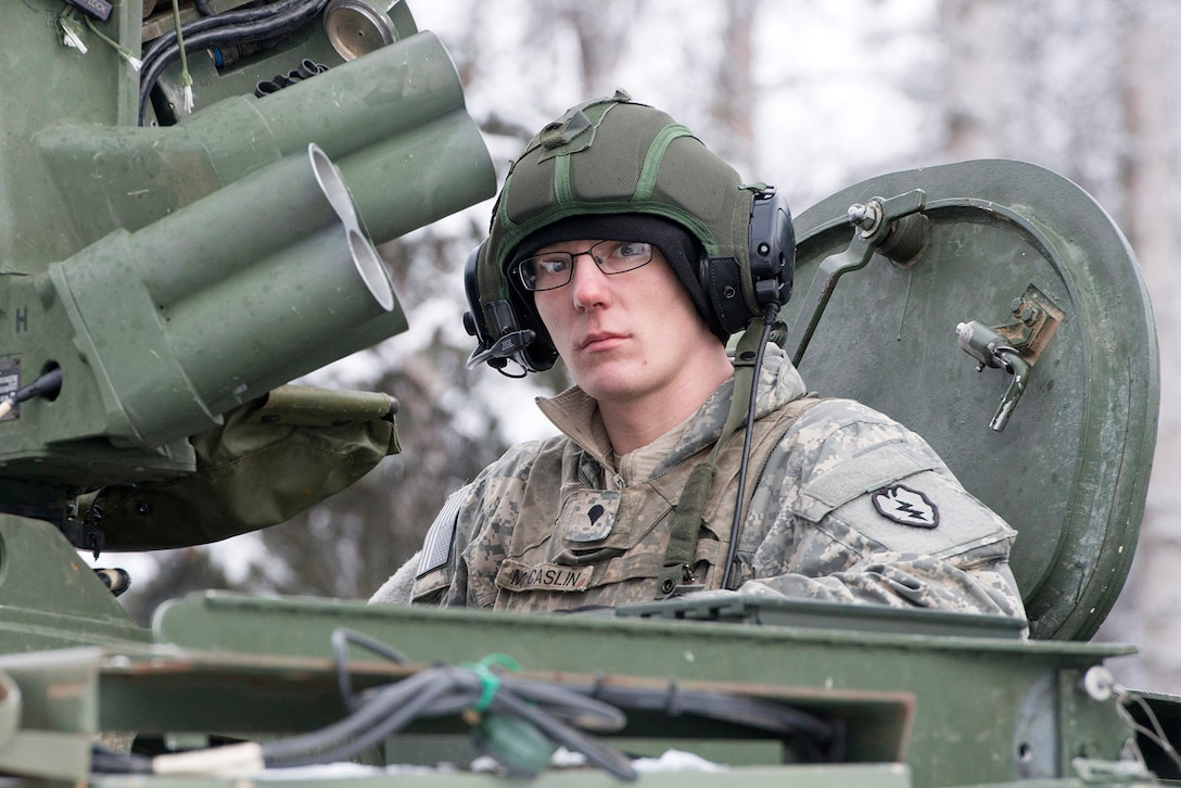 Spc. Austin McCaslin, assigned to Bayonet Company, 1st Battalion, 5th Infantry Regiment, 1st Stryker Brigade Combat Team, 25th Infantry Division, U.S. Army Alaska, prepares for live-fire gunnery training during Operation Punchbowl at Joint Base Elmendorf-Richardson, Alaska, Feb. 16, 2018. Operation Punchbowl was a battalion-level, combined arms, live-fire exercise that focused on arctic lethality.