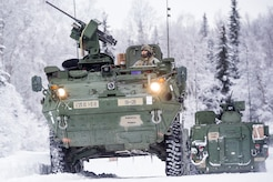 Army 1st Lt. Daniel Choi, assigned to Bayonet Company, 1st Battalion, 5th Infantry Regiment, 1st Stryker Brigade Combat Team, 25th Infantry Division, U.S. Army Alaska, orders his crew to maneuver into position to enter the range for gunnery on Joint Base Elmendorf-Richardson, Alaska, during Operation Punch Bowl as another leaves after finishing firing. The Fort Wainwright based Soldiers' operation culminated with multiple live-fire and combat training events.