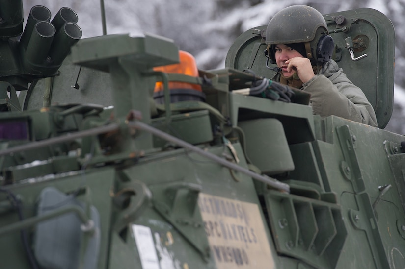 A vehicle commander assigned to the 1st Battalion, 5th Infantry Regiment, 1st Stryker Brigade Combat Team, 25th Infantry Division, U.S. Army Alaska, speaks into his head set as he prepares for gunnery on Joint Base Elmendorf-Richardson, Alaska, during Operation Punch Bowl. The Fort Wainwright based Soldiers' operation culminated with multiple live-fire and combat training events.