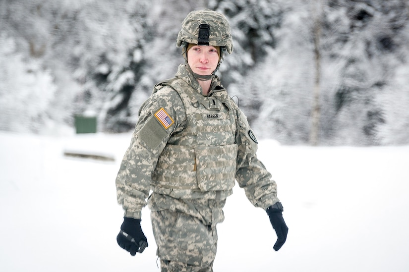Army 1st Lt. Christopher Barber, assigned to the 1st Battalion, 5th Infantry Regiment, 1st Stryker Brigade Combat Team, 25th Infantry Division, U.S. Army Alaska, walks near the ammunition supply point as fellow Soldiers prepare for gunnery on Joint Base Elmendorf-Richardson, Alaska, during Operation Punch Bowl. The Fort Wainwright based Soldiers' operation culminated with multiple live-fire and combat training events.