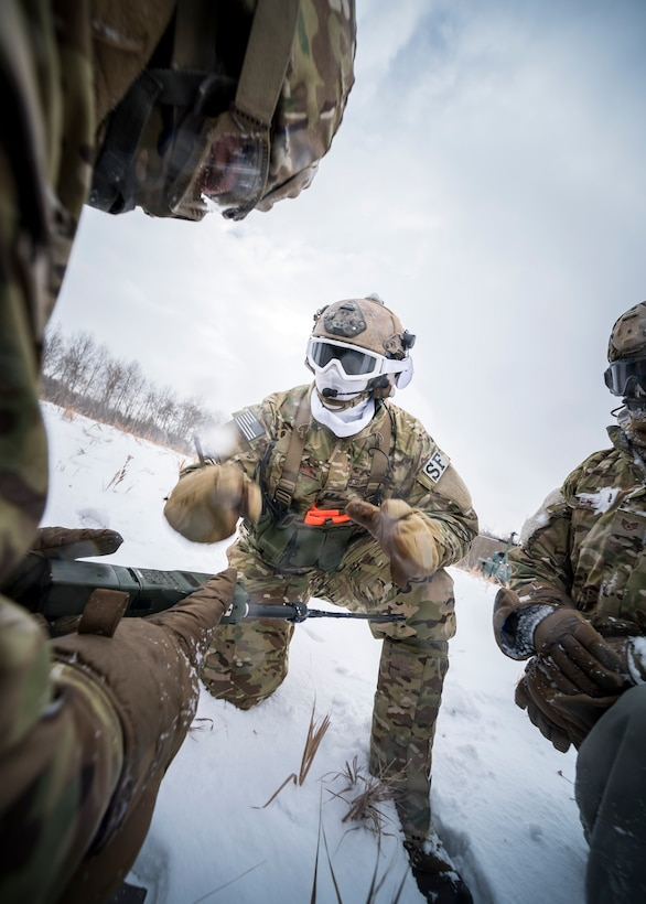 Defenders from the 91st Security Forces Group vector in a helicopter in the Turtle Mountain State Forest, N.D., Feb. 14, 2018, during a 91st Security Forces Group field training exercise. During the FTX, defenders vectored the aircraft to the landing zone and performed a simulated emergency medical evacuation. (U.S. Air Force photo by Senior Airman J.T. Armstrong)