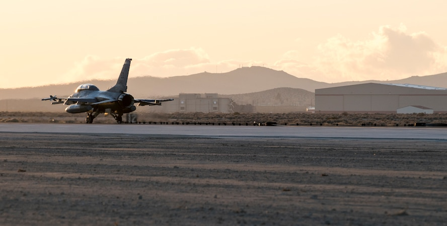An Edward F-16 catches the arresting cable on an Edwards runway as part of a certification engagement of a newly overhauled aircraft arresting system Jan. 25. Members of the 412th Civil Engineer Squadron began installing the new system last November. (U.S. Air Force photo by Brad White)