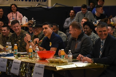 U.S. Air Force Col. Ricky Mills, 17th Training Wing commander, speaks with the other judges, U.S. Marine Maj. Andrew Armstrong, Marine Corps Detachment commanding officer, U.S. Army Lt. Col. Yukio Kuniyuki, 344th Military Intelligence Battalion commander, U.S. Air Force Maj. Melvin Smith, chaplain, and U.S. Air Force Lt. Col. Kenneth Stremmel, 315th Training Squadron commander, during the 11th Annual Talent Show at the Crossroads on Goodfellow Air Force Base, Texas, Feb. 16, 2018. The judges picked their favorite performers out of the 11 competitors. (U.S. Air Force Photo by Airman 1st Class Zachary Chapman/Released)