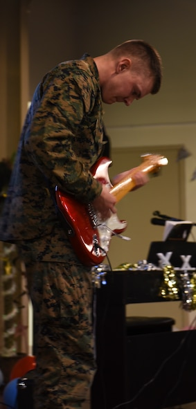U.S. Marine Corps. Pfc. Connor Morgan, Marine Corps Detachment trainee, performs a guitar solo during the 11th Annual Talent Show at the Crossroads on Goodfellow Air Force Base, Texas, Feb. 16, 2018. The Talent Show was open to the trainees from Goodfellow and gave them a chance to find out who is the best on base. (U.S. Air Force Photo by Airman 1st Class Zachary Chapman/Released)