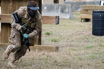 Airman 1st Class Elijah Bishop, 347th Operations Support Squadron intel analyst, runs to cover during a Tactical Combat Casualty Care course, Feb. 14, 2018, at Moody Air Force Base, Ga. The training is designed to teach Airmen how to apply critical life-saving skills while engaged in a combat environment. (U.S. Air Force photo by Airman 1st Class Erick Requadt)