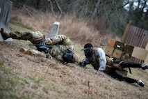 Airman 1st Class Andruw Reyes, right, 23d Maintenance Squadron nondestructive inspection technician, lunges toward Staff Sgt. Michael Triana, 347th Operations Support Squadron, in a high threat evasion scenario during a Tactical Combat Casualty Care course, Feb. 14, 2018, at Moody Air Force Base, Ga. The training is designed to teach Airmen how to apply critical life-saving skills while engaged in a combat environment. (U.S. Air Force photo by Airman 1st Class Erick Requadt)